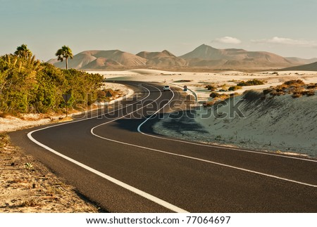 Winding road across the dunes of Corralejo, Fuerteventura, in the Canary Islands, Spain.