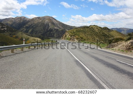 Winding road ahead into the mountains