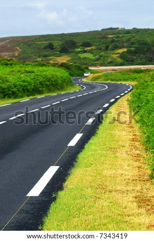Winding road along the ocean coast in Brittany, France - stock photo