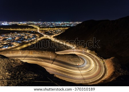Winding road and the city of Muscat at night. Sultanate of Oman, Middle East