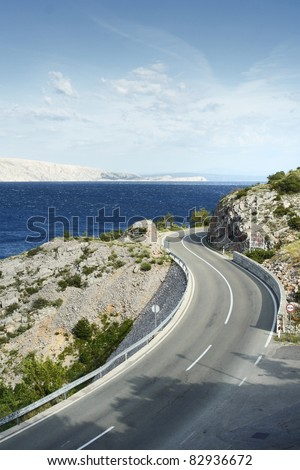 Winding road by the sea - stock photo