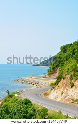 Winding road by the sea in Thailand - stock photo