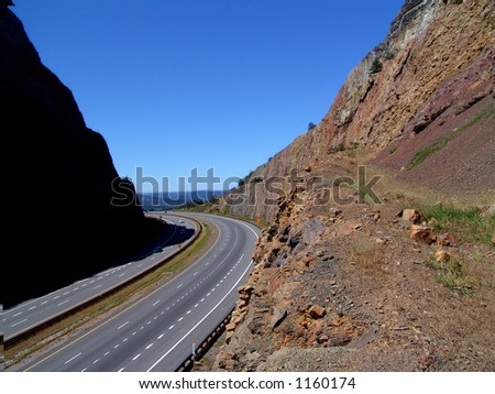 winding road cut in mountain