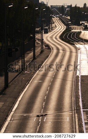 Winding road in a big german city - stock photo
