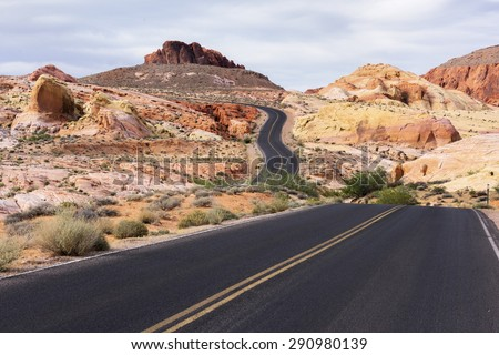 Winding road in desert landscape of Valley of Fire State Park, Nevada. - stock photo