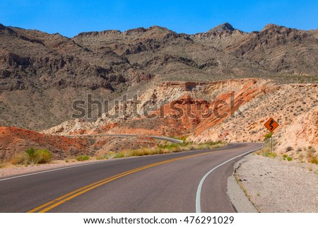 Winding road in dry dessert landscape