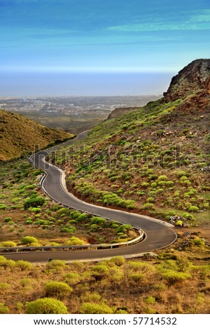 Winding road in mountains of Gran Canaria in Canary Islands - stock photo