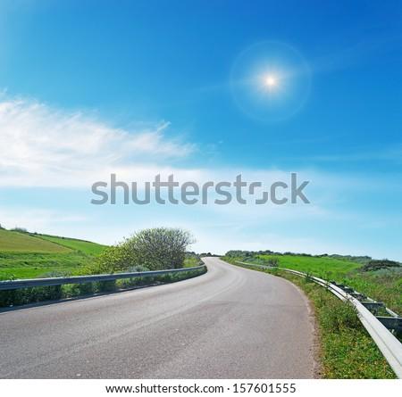 winding road in sardinian countryside - stock photo