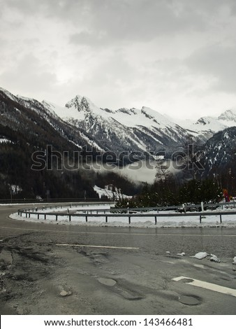 winding road in the Alps - stock photo