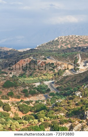 Winding road in the hills - stock photo