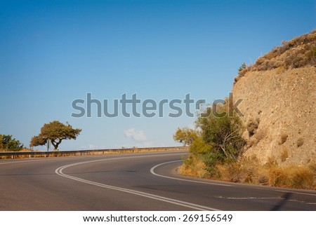 winding road in the rocks - stock photo