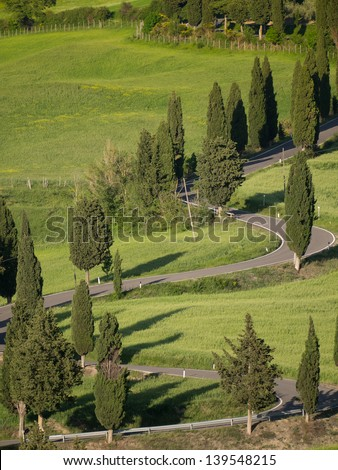 Winding road near monticchiello in Tuscany at sunset - stock photo