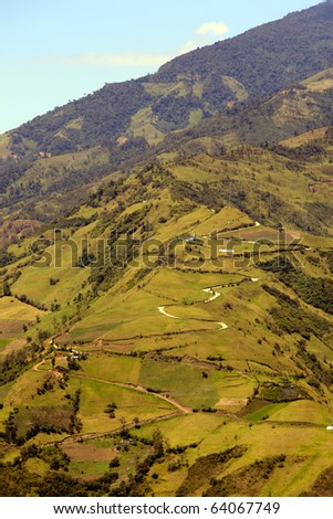 winding road that climbs in the Andes mountains  , Ecuador - stock photo