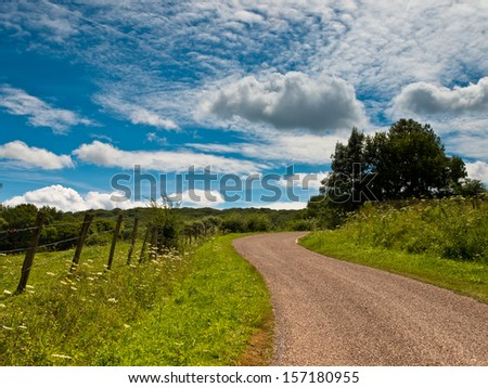 Winding Road Through the Countryside in France - stock photo