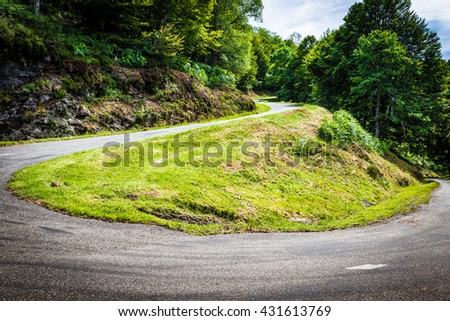 Winding road with sharp bend going up the mountain in the Pyrenees in France