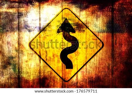 Winding roadsign on a grunge wood background  - stock photo