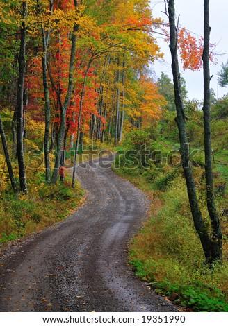 Winding rural mountain road in Autumn - stock photo