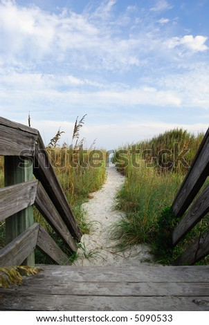 winding sand trail leading to beach from deck - stock photo