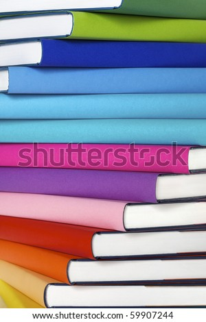 Winding stack of colorful real books with space for text on spines. - stock photo