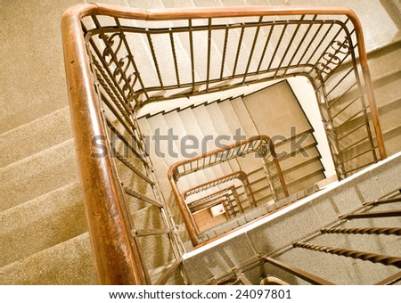 Winding staircase in an hotel, seen from above - stock photo
