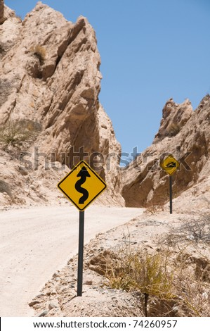 Winding steep mountain road road with road signs, south of Cachi, Argentina - stock photo