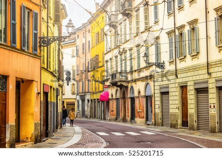 Winding street with colorful houses in Parma, Emilia-Romagna, Italy.