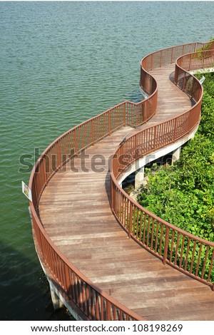 Winding Wooden Bridge Along The Coastline - stock photo