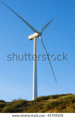 windmil in the top of a mountainl and blue sky