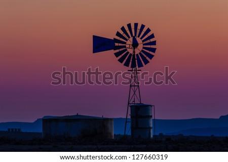 Windmill after sunset, Southwestern Colorado - stock photo