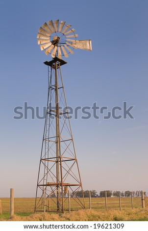 Windmill against blue sky.