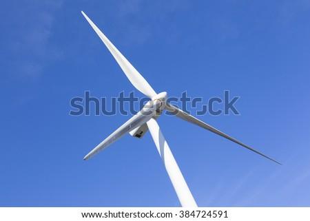 Windmill against blue sky - stock photo
