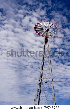 Windmill against dramatic sky - stock photo