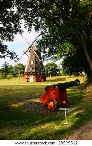 Windmill and Cannon at Kastellet - stock photo