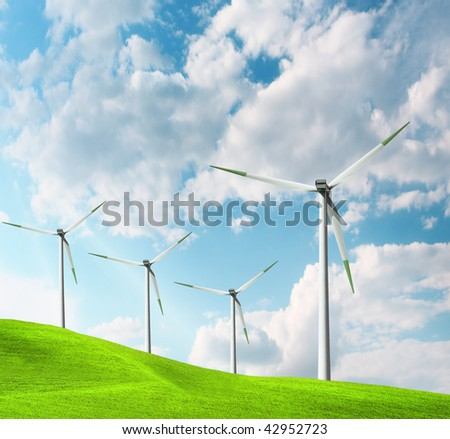 Windmill and cloudy blue sky