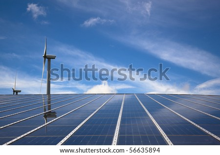 windmill and solar panel with cloud sky - stock photo