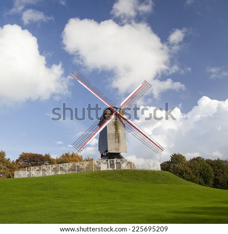 Windmill at autumn day, Bruges, Belgium - stock photo