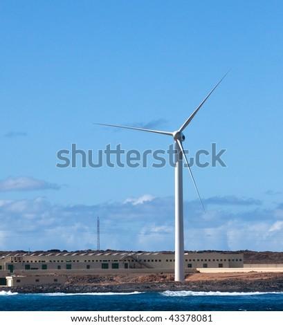 windmill at sea - stock photo