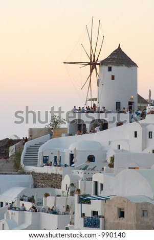 Windmill at sunset Oia Santorini Greece - stock photo