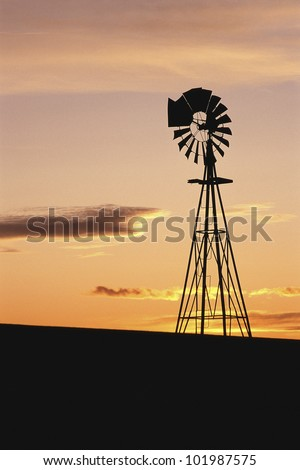 Windmill at sunset, South Dakota - stock photo