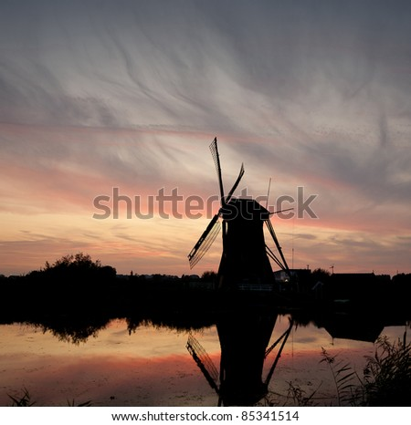 Windmill at sunset with colorful sky. Kinderdijk,the Netherlands - stock photo