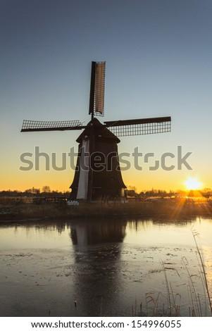 Windmill at the sunet in Alkmaar, Netherlands - stock photo