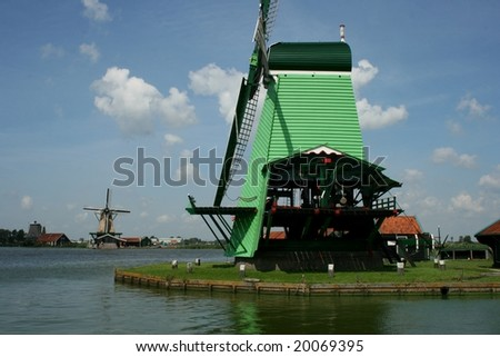 Windmill at the Zaanse Schans, touristic village nearby Amsterdam