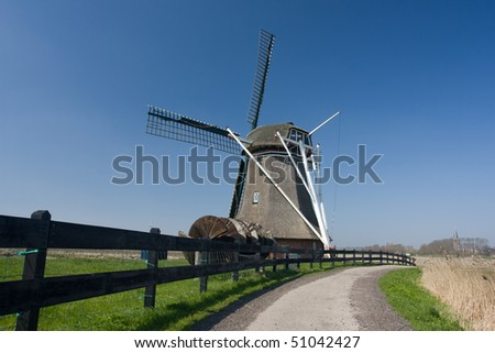 Windmill behind a fence
