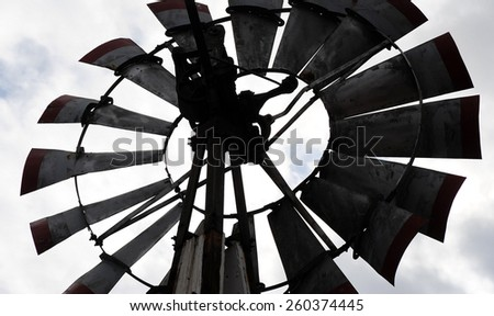 Windmill fan displayed outdoors. - stock photo