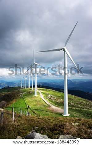 windmill farm in mountain with beautiful light - stock photo