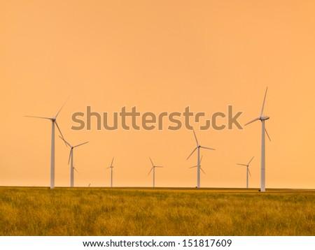 Windmill farm in Pawnee Buttes in northeastern Colorado. - stock photo