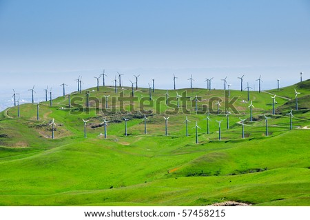 Windmill farm on rolling green hills in California - stock photo