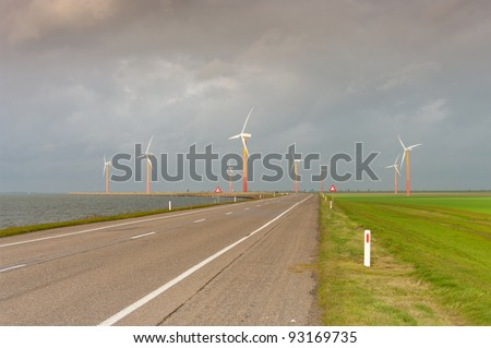 windmill farm with colorful windmills in Almere, Netherlands