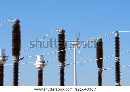 windmill for  electric power production and  electrical substation - stock photo