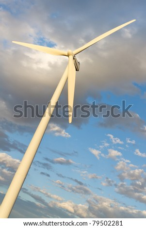 Windmill generating clean renewable electrical energy without carbon dioxide emissions to fight climate change and global warming.